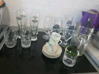 Various glasses dinner set and suitcase