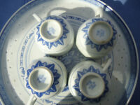 4 delicate Chinese 'rice grain type porcelain cups and serving tray.