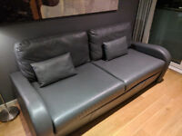 Three seater faux leather sofa beds, excellent condition, provides two single beds
