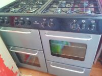 Duel fuel double oven and hob. New world. Very good condition. Width 54cms length 100cms.