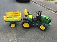 SOLD.......John Deer electric tractor and trailer