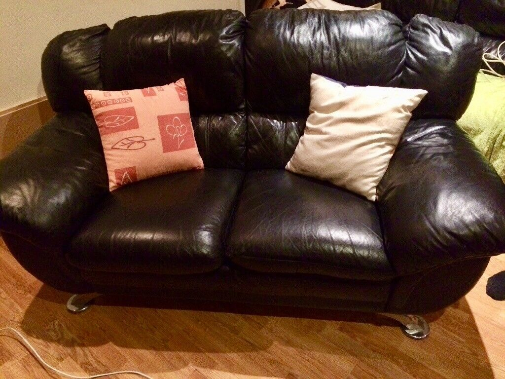 2 seater leather, black sofa.. great condition