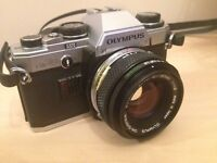 Olympus OM10 SLR camera with additional lens, tripod and flash