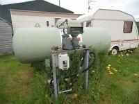 LPG storage tank with pump and retail standard meter. Liquid or gar take off points.