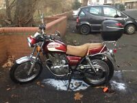 Suzuki Volty Superclassic 250cc bike in burgundy and tan