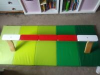 Ikea wooden gymnastic beam and gym mat.