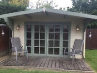 Used Summerhouse 4m wide x 3m deep plus decking area 1.1m good quality 28mm thick tongue & groove