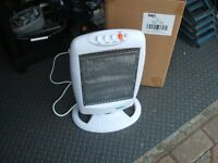 Portable Coopers oscillating halogen heater. Brand new, still in box. 47 cm high.