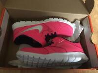 Pink Nike flex experience 3 trainers