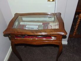 Curio display table - glazed top and sides. Bow legs. Mid-gold walnut finish.