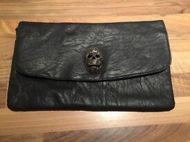 Black skull detail clutch bag