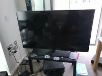 Samsung 58Inch TV, only £300 with TV table + fire tv stick