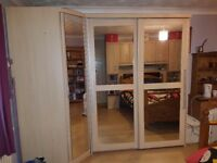 Double sliding door wardrobe and corner wardrobe all mirrored.