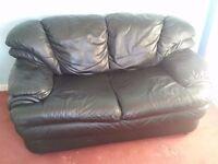 FREE black leather 2 seater sofa.