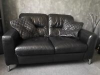 Black leather 2 seater sofa and footstool with chrome legs