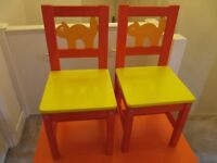 IKEA CHILDREN'S WOODEN TABLE AND TWO CHAIRS - ORANGE/YELLOW