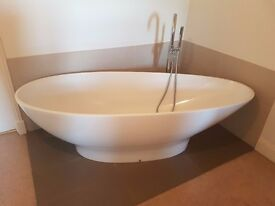 Freestanding bath and chrome mixer tap with hand held shower for sale