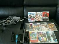 Black Nintendo Wii console with 10 games and two controllers