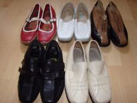 Bundle of womens leather shoes.