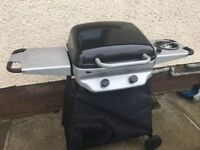BBQ with gas canister andine side table the other with gas burner