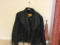 Ladies Leather biker jacket , worn once tassels on sleeves and back