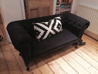 Chic black fabric Chesterfield sofa. Small two seater. vintage inspired
