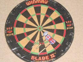 Dart Board & a Set of Darts