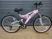 LADIES / TEENAGERS TRAX DUAL SUSPENSION BIKE IN ALMOST NEW CONDITION (USED ONCE)..