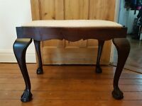 African hard wood piano stool, beautifully hand carved feet and newly reupholstered