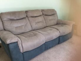 .TWO three seater electric reclining sofas, from dfs teal and silver.
