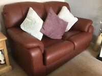 2 x 2 seater leather settee and 1 swivel leather armchair
