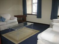 Furnished 2 bed flat with private parking, close to town centre, college & hospital.