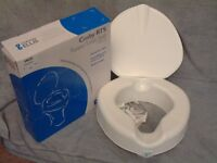 "New boxed Cosby RTS raised toilet seat with lid, 4"" high, clamps, modern design"