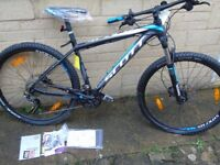 brand new 2014 scott scale 760 mountain bike, still in box, never used.