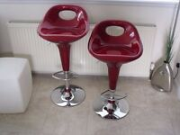 Two gas lift bar stools