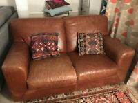2 seater leather sofa. FREE to a good home