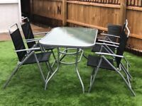 Garden table and 4 matching chairs