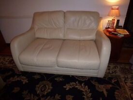 2 x 2 seater real leather sofas - (pebble) cream £100 for the 2
