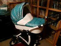 Nearly new pram with brand new buggy attachment!