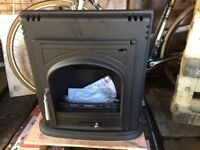 Inset wood burning stove - not used, lacking front glass