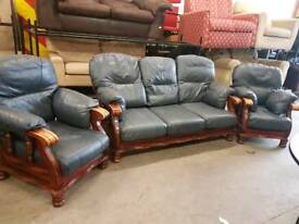 Large blue leather wooden framed 3 seater and 2 chairs