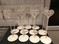 Heart shaped love birds table number stand
