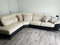 Corner sofa - cream and black leather with stylised metal feet - DFS Dice range - 3 years old