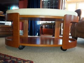 Table - low oval shape coffee table on casters with removable fitted cushion