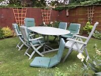 Wooden garden table with six chairs and cushions