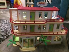Playmobil Hotel (5265) , Playmobil disco (5266) and extra hotel suite (5269). Fully furnished.
