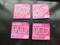 Four Minidisc MD-R 80 recordable discs, unused in sealed packaging