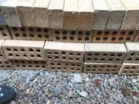 Breeze blocks and bricks orange facing and grey bricks