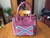A lovely, one of a kind Rebel Handbag from Montana West.