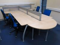 4 Person desk pod with semi-circular end table by Senator and 4 x Senator blue operators chairs